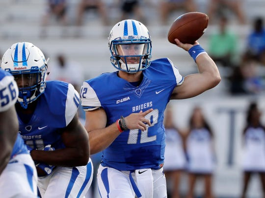 FILE - In this Sept. 3, 2016, file photo, Middle Tennessee quarterback Brent Stockstill (12) passes against Alabama A&M in the first half of an NCAA college football game, in Murfreesboro, Tenn. Wrapping a quarterback in bubble wrap isn't possible no matter how much a coach might want to keep him safe. The Middle Tennessee Blue Raiders can only hope Brent Stockstill stays healthy all season long.  (AP Photo/Mark Humphrey, File)