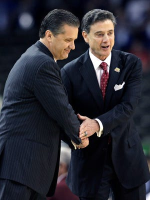 In this March 31, 2012, file photo, Louisville head coach Rick Pitino, right, shakes hands with Kentucky head coach John Calipari before the first half of an NCAA Final Four semifinal college basketball tournament game in New Orleans.