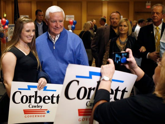 Pennsylvania Gov. Tom Corbett poses for a photo with supporters during a campaign stop with other local Republican party elected officials on Monday, Nov. 3, 2014, in Coraopolis, Pa.