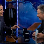 "President Barack Obama talks with Jon Stewart during a 20012 taping of ""The Daily Show with John Stewart."" Stewart signs off for good Aug. 6."