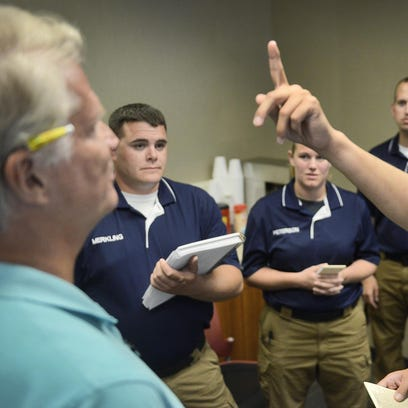 Minnesota State Trooper Gabe Cornish demonstrates a field sobriety test for St. Cloud Police Department recruits as Times columnist Dave DeLand tries to follow Cornish's finger during training Monday at the St. Cloud Police Department. After volunteering to become intoxicated for the test, DeLand's eyes cannot smoothly follow the finger and seem to bounce back and forth at the outer limits of their movement. It's a classic sign of intoxication. Other volunteers also participated in the training.