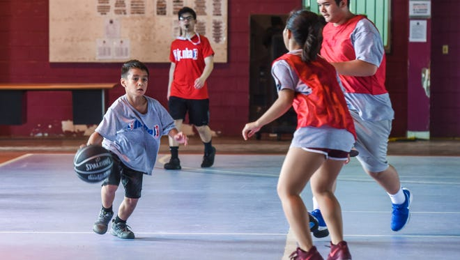 Camp participants wrap up their training during the final day of the 2017 Holiday Youth Camp at the Tamuning gym on Friday, Dec. 29, 2017.