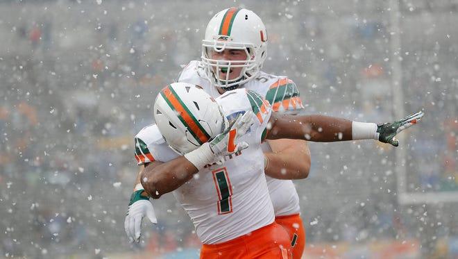 Miami's Mark Walton celbrates his touchdown against Washington State Saturday in the Hyundai Sun Bowl in El Paso.