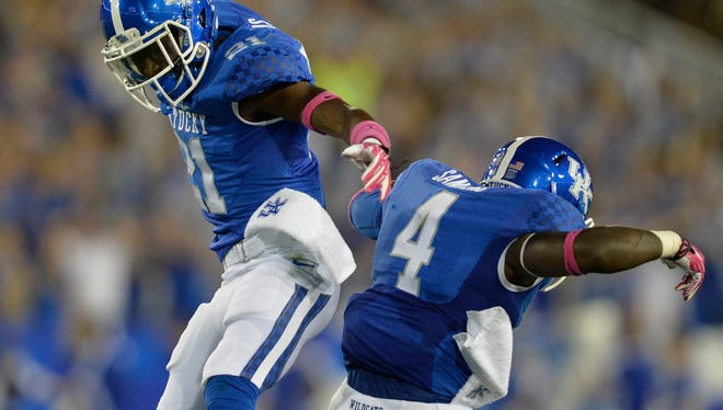 Kentucky's Nate Willis, left, and Raymond Sanders III celebrate following an Alabama turnover during the first quarter of last season's game at Commonwealth Stadium.