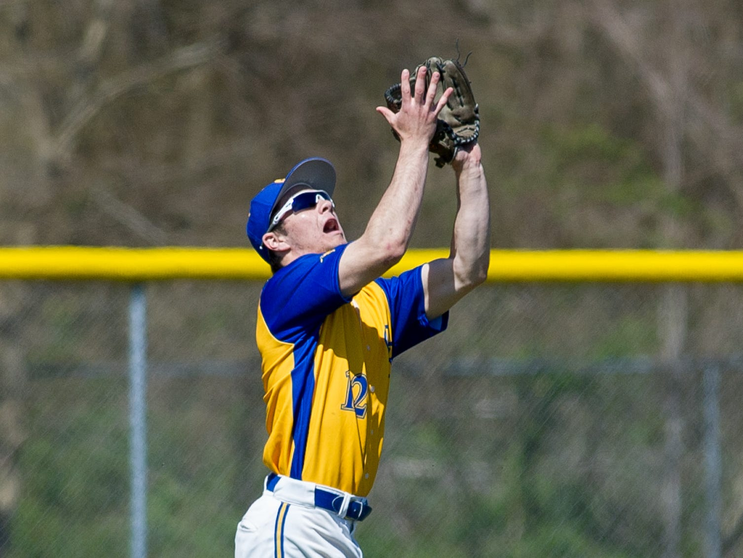 Caesar Rodney's Thomas Gallucci (12) catches a fly ball in the first inning against St. Marks.