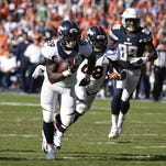 Denver Broncos inside linebacker Danny Trevathan scores on a interception against the San Diego Chargers during the first half in an NFL football game Sunday, Dec. 6, 2015, in San Diego.