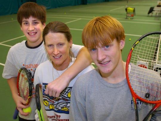 From left, Matt Allare,14, Bunnie Allare and John Allare,