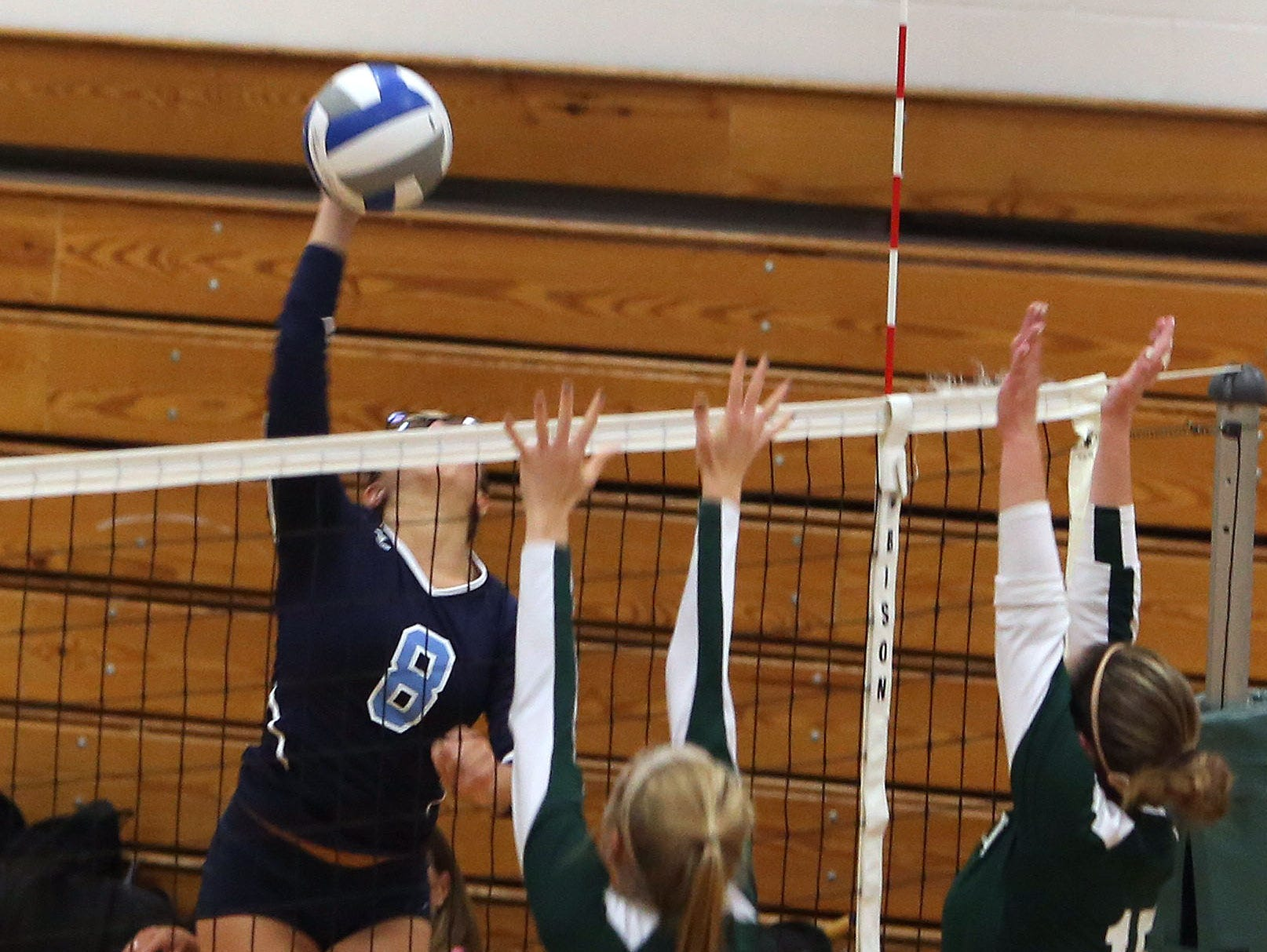 From left, Westlake's Sydney Roell (8) gets a shot by Pleasantville's Annie Stockel (10) and Carolyn Meaney (15) during volleyball action at Pleasantville High School Sept. 30, 2015.