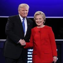Republican presidential nominee Donald Trump speaks as Democratic presidential nominee Hillary Clinton listens during the Presidential Debate at Hofstra University on September 26, 2016 in Hempstead, New York.