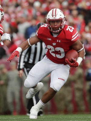 Wisconsin's Jonathan Taylor was named to the 2018 AP All-America NCAA college football team.