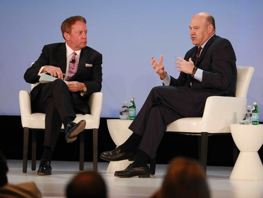 Terry Duffy, left, CME Group executive chairman and