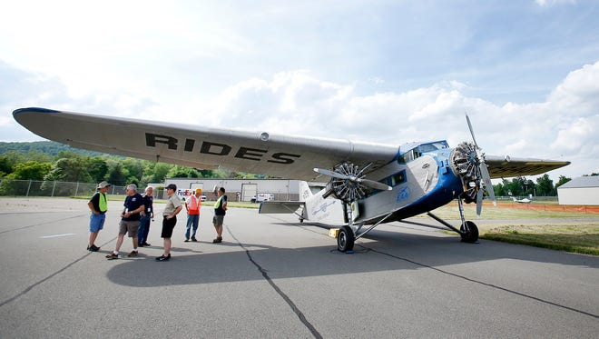 The 1929 Ford Tri-Motor propeller plane is stationed in a hangar near the Elmira Corning Regional Airport. The public is welcome to view the plane and may ride it for a fee.