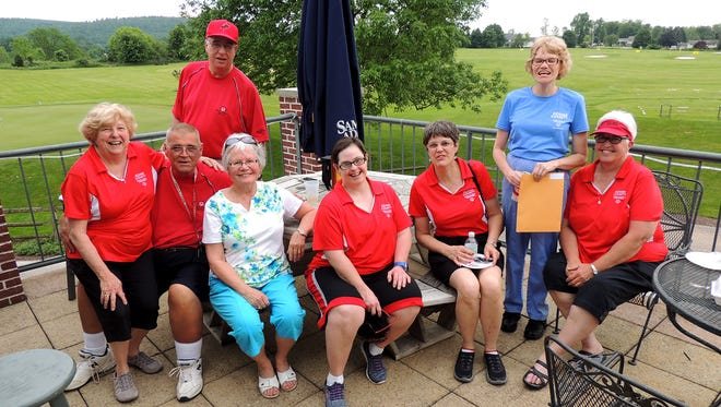 Grace Myers, seated, third from left, is surrounded by athletes and a few members of the management team following the Special Olympics Adams County's 21st annual Golf Tournament. As fundraising coordinator and past county manager, Grace has been the driving force behind the success of all 21 Golf Challenges. Seated, from left, are: Barb Evans, John Martin, Myers, Mary Beth Stine, Terry Stickles and Darlene Stone; standing, Denny Murphy and Barbara Latham.