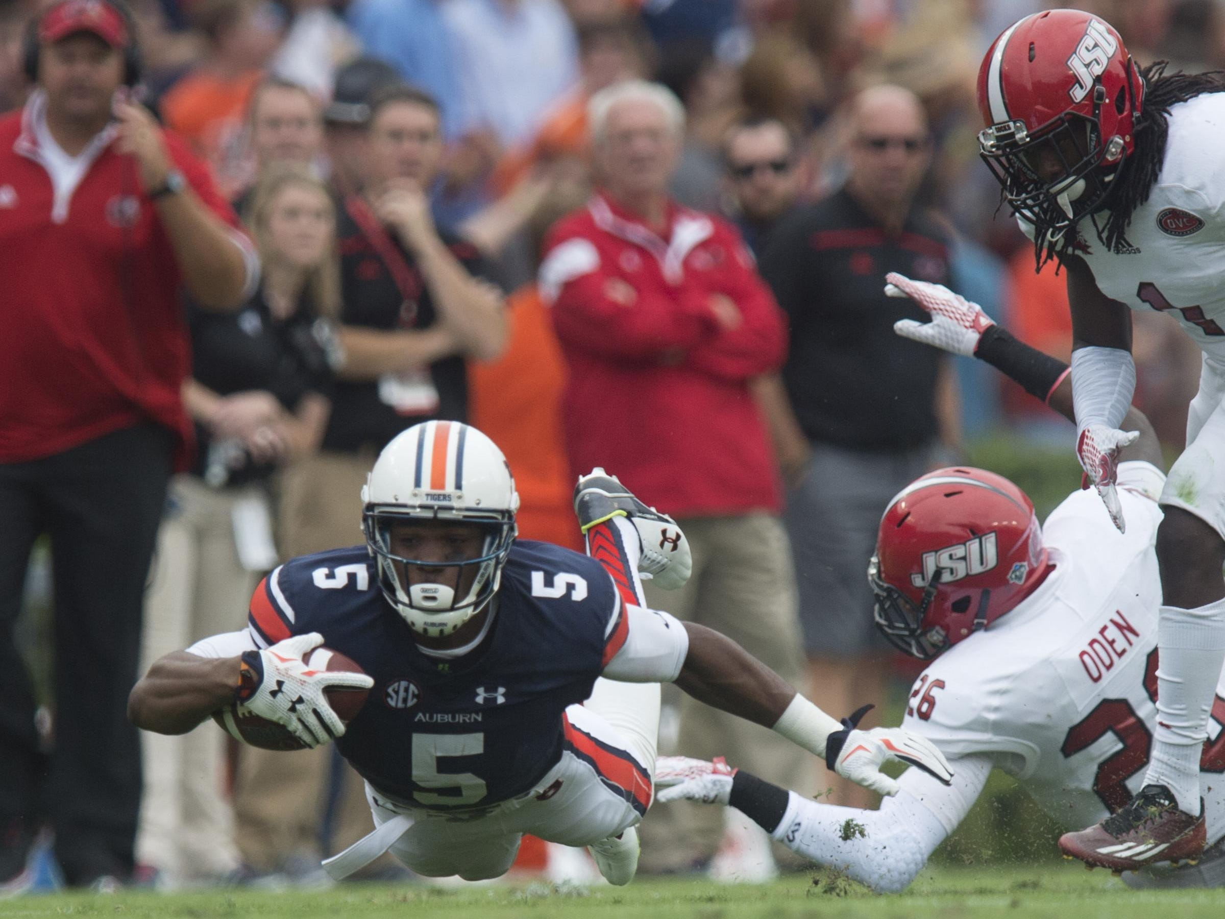 Auburn Tigers wide receiver Ricardo Louis (5) dives forwards as Jacksonville State Gamecocks safety Santavious Oden (26) tackles him during the first half of the NCAA Auburn vs. Jacksonville State on Saturday, Sept. 12, 2015, in at Jordan-Hare Stadium in Auburn, Ala.Albert Cesare / Advertiser