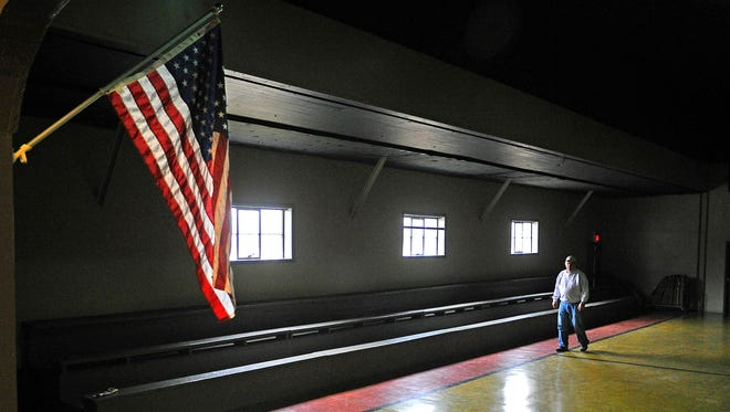 Steve Allemore, president of the Nolensville Historical Society, walks through the Nolensville School gym. The historical society has raised more than $75,000 and needs about $30,000 more for final restorations of the school.