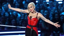 Whoops! Lady Gaga let an F-bomb fly while handing out