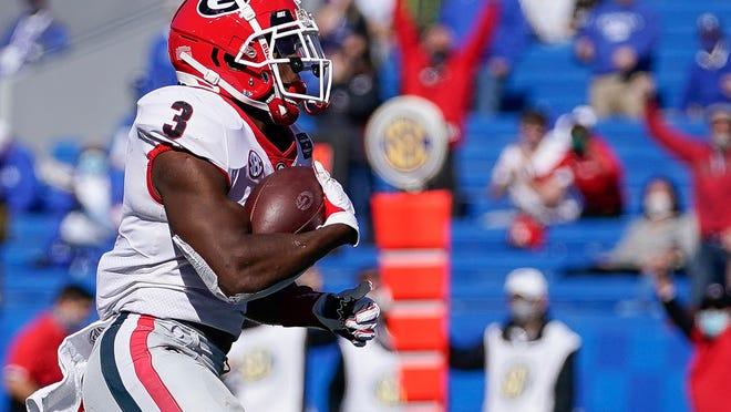 Scotland grad Zamir White rushed for a career-high 136 yards and a touchdown in fifth-ranked Georgia's 14-3 win at Kentucky on Saturday.