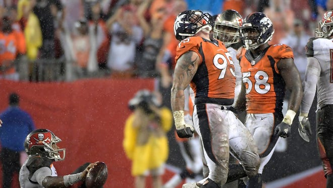 Denver Broncos defensive end Derek Wolfe (95) celebrates after sacking Tampa Bay Buccaneers quarterback Jameis Winston. Wolfe is the unsung member of Denver's dazzling defense.