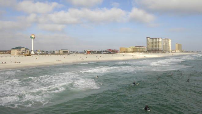 Surfers enjoy a warm afternoon at Pensacola Beach.