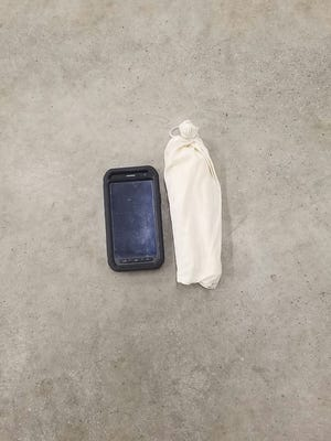 K-9 Search on Site, a limited liability canine search company, lost a small bag of explosives, similar to this one, in the city of Oak Ridge on Friday, March 11. (The phone in this photo was included for size reference.)