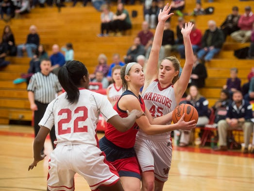 New Oxford's Kaelyn Long drives toward the basket against