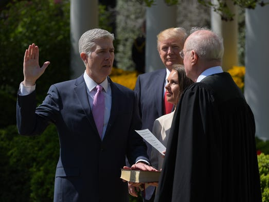 President Trump watches as Justice Anthony Kennedy