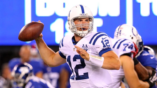 Indianapolis Colts quarterback Andrew Luck (12) drops back to pass against the New York Giants during the second quarter of a preseason game at MetLife Stadium.