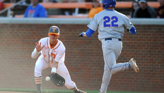 Florida's JJ Schwarz, right, beats the throw to Tennessee first baseman Jordan Rodgers during a game last season at Lindsey Nelson Stadium.