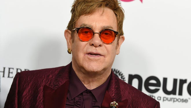 In this March 25, 2017 file photo, Elton John arrives at Elton John's 70th Birthday and 50-Year Songwriting Partnership with Bernie Taupin celebration in Los Angeles.