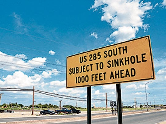 This sign warns drivers of the potential dangers of the brine well near the South Y.