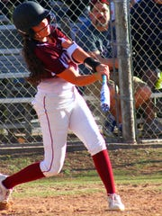 Tularosa eighth-grader Conjetta Little makes contact with the ball Friday evening.