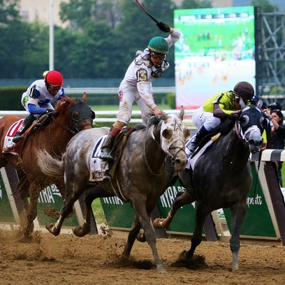 ELMONT, NY - JUNE 11:  Creator with jockey Irad Ortiz Jr. up leads the field to the finish to win the The 148th running of the Belmont Stakes at Belmont Park on June 11, 2016 in Elmont, New York.  (Photo by Mike Stobe/Getty Images) ORG XMIT: 637228051 ORIG FILE ID: 539489238