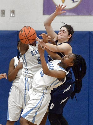 Swift of foot and a player who anticipates well, Bishop Kearney senior guard Allure Simmons, bottom, gives opponents fits because of her tenacious defense.