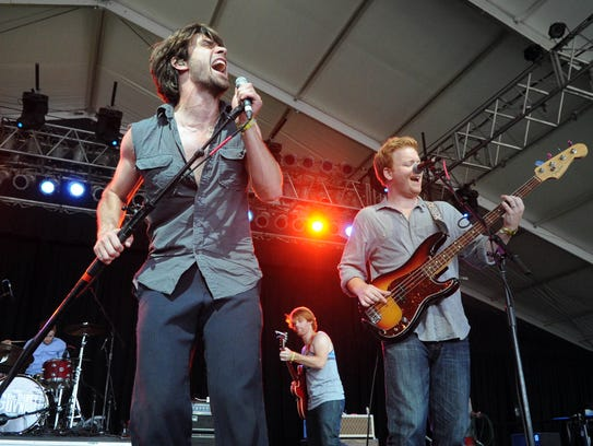 The Dirty Guv'nahs perform in This Tent during the 11th annual Bonnaroo Music and Arts Festival in Manchester, Tenn., Thursday, June 7, 2012. Lead singer James Trimble, left, is joined by band mates Michael Jenkins, center, and Justin Hoskins, right.