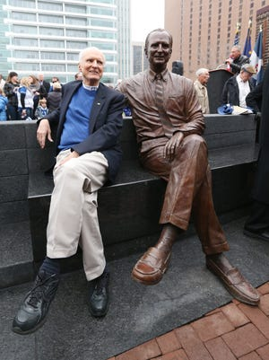 Former Indianapolis Mayor Bill Hudnut mimics the pose of his bronze twin Mayor Bill. The sculpture, dedicated Sunday, was paid for by more than $250,000 in private donations.
