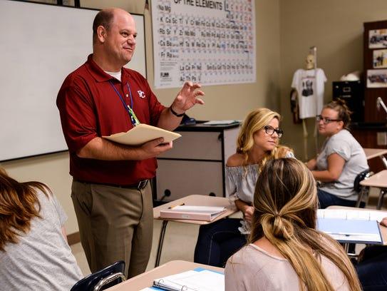 Chuck Conrad teaches science at D.W. Daniel High School