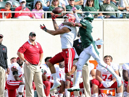 Michigan State cornerback Justin Layne breaks up a pass against Indiana last season.