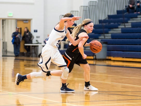 Marine City's Erin Davis (right) dribbles around Marysville's