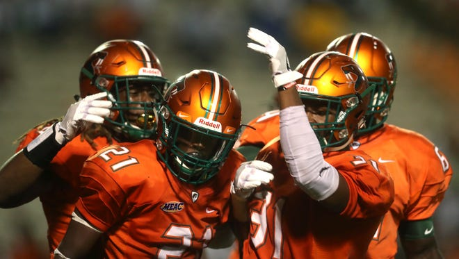 FAMU teammates celebrate with Elijah Daniels (No. 21) after his sack for a safety against Fort Valley State University.