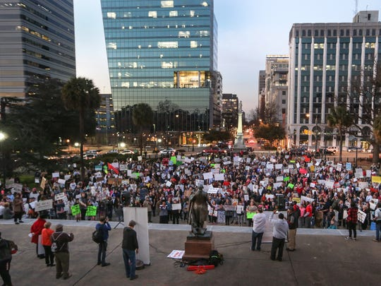 Hundreds of people brought their message against President Trump's executive order temporarily banning some immigrants from entering the United States during a demonstration at the South Carolina State House on Tuesday, Jan. 31, 2017.