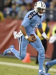 Titans quarterback Marcus Mariota (8) moves the ball
