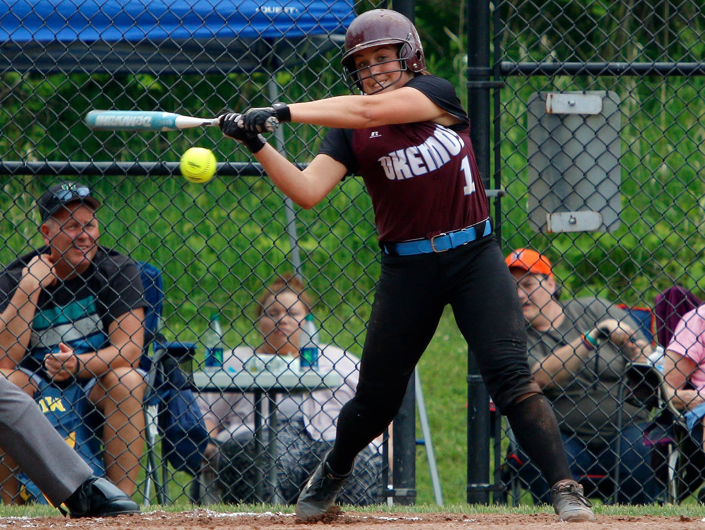 Kate Buckland and the Okemos softball team have overcome adversity this spring to capture a district title.