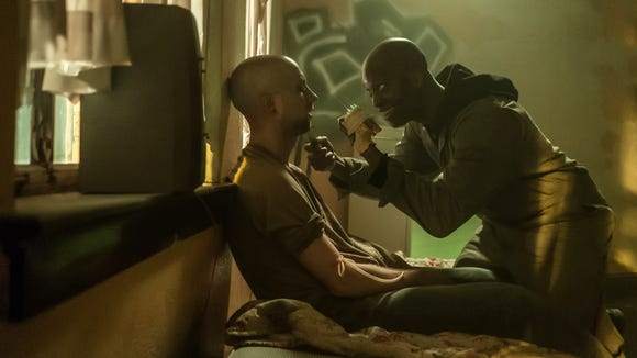 "The freaky Skeletor (Rotimi Paul, right) finds a victim in ""The First Purge"" (July 4), a horror prequel about the events that led to the Purge, the one night a year where all crime — including murder — is legal."