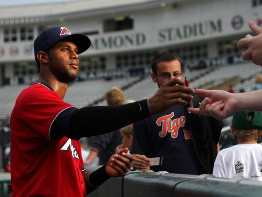 Fort Myers Miracle center fielder Aaron Hicks signs autographs in 2011 before taking the field against the Charlotte Stone Crabs at Hammond Stadium in Fort Myers.