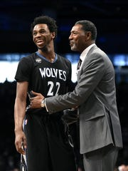 Head coach Sam Mitchell talks with Minnesota Timberwolves guard Andrew Wiggins. Mitchell was Minnesota's head coach for the 2015-16 season.