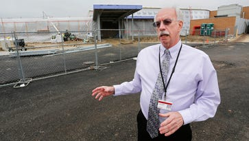 Lafayette School Corporation Superintendent Les Huddle talks about the expansion taking place (background) Wednesday, January 18, 2017, at Sunnyside Intermediate School in Lafayette. Huddle said ten classrooms are being added to the school. The cafeteria is also being expanded.