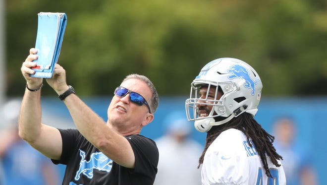 Lions linebackers coach Bill Sheridan works with Jalen Reeves-Maybin, right, during practice Aug. 22, 2017 in Allen Park.
