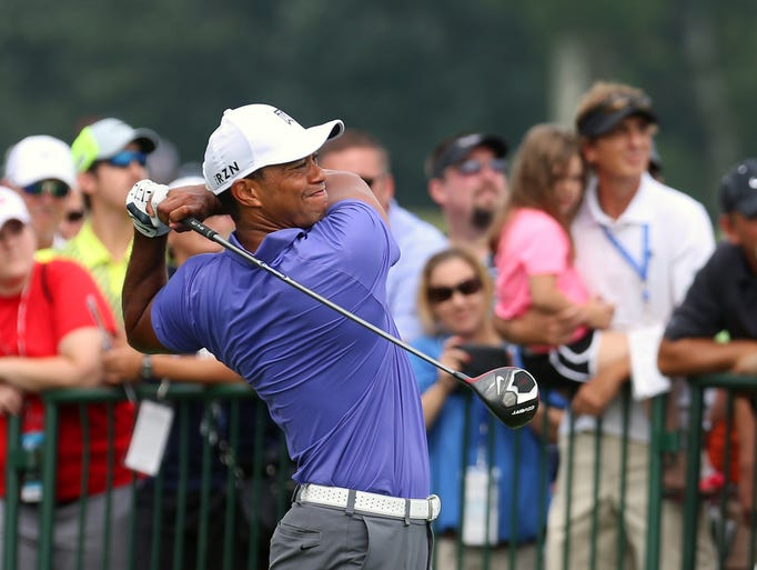 Tiger Woods tees-off at hole one in the PGA Championship at Valhalla. Aug. 7, 2014