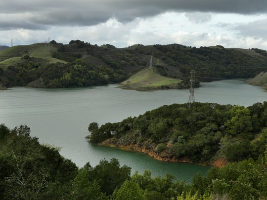 In this Wednesday, Jan. 11, 2017, photo, Briones Reservoir is seen near capacity in Orinda, Calif., following a series of storms.