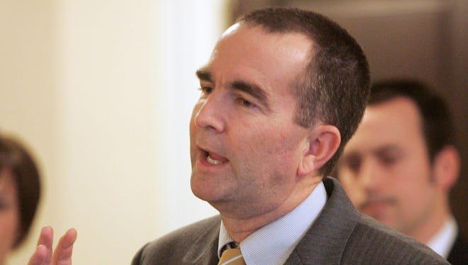 Gov. Ralph Northam gestures during a press conference at the Capitol in Richmond.